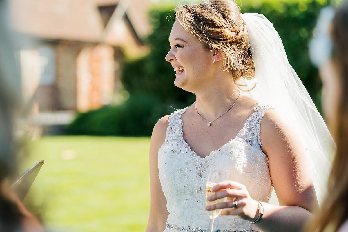 bride smiling at southend barns